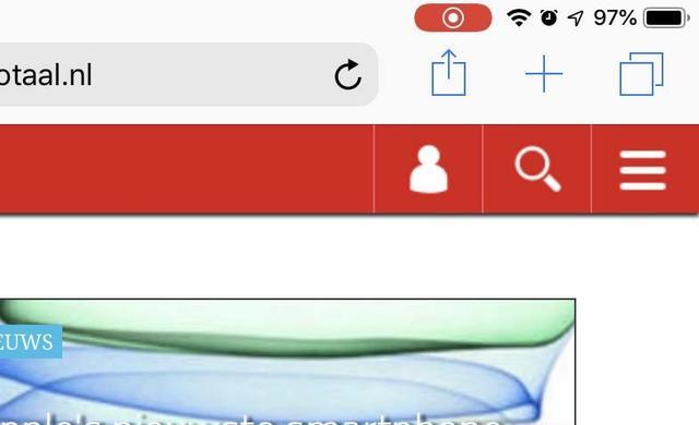 De rode indicator geeft aan dat er een schermvideo-opname loopt in iOS; het is tevens de stop-knop