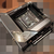 Gelekte foto van het ASUS ROG Strix Z690-I Gaming Wi-Fi-moederbord, met een gelaafd ontwerp.