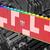 Render van een rode Galax Gamer RGB DDR5-geheugenschijf met Lego-compatibele nopjes.